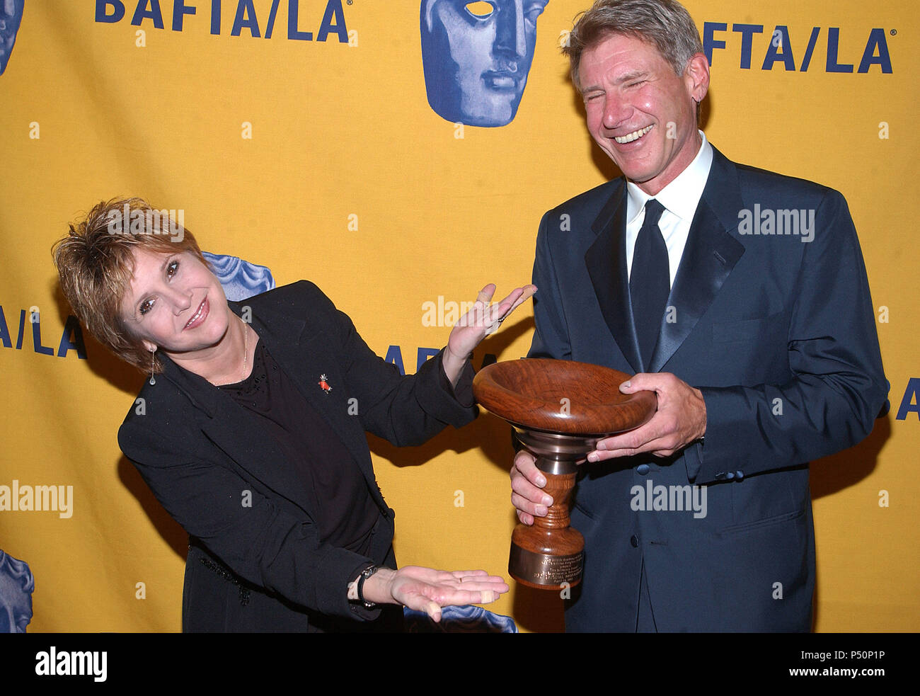 Carrie Fisher and Harrison Ford at The 11th Annual BAFTA-LA -Britannia Awards presented to George Lucas at the Beverly Hilton in Los Angeles. April 12,  2002.             -            FisherCarrie_FordHarrison01.jpgFisherCarrie_FordHarrison01  Event in Hollywood Life - California, Red Carpet Event, USA, Film Industry, Celebrities, Photography, Bestof, Arts Culture and Entertainment, Topix Celebrities fashion, Best of, Hollywood Life, Event in Hollywood Life - California,  backstage trophy, Awards show, movie celebrities, TV celebrities, Music celebrities, Topix, Bestof, Arts Culture and Entert - Stock Image