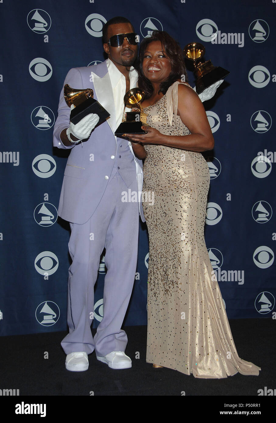 Kanye West and mom backstage at the 48th Grammy Awards at