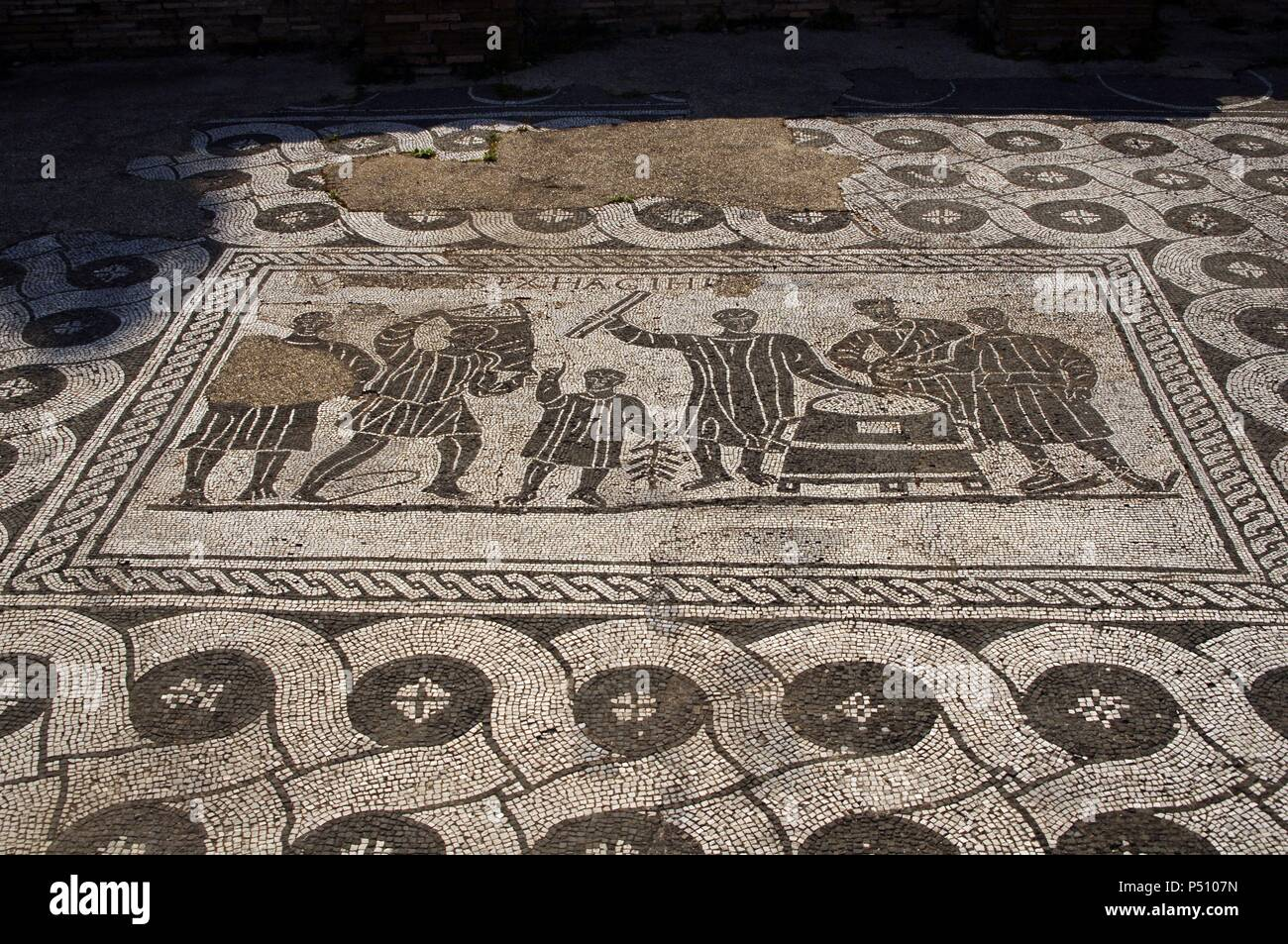 Ostia Antica. The Hall of the Grain Measurers. 3rd century. Mosaic depicting grain measurers (mensores frumentariiI) at work. Italy. Stock Photo