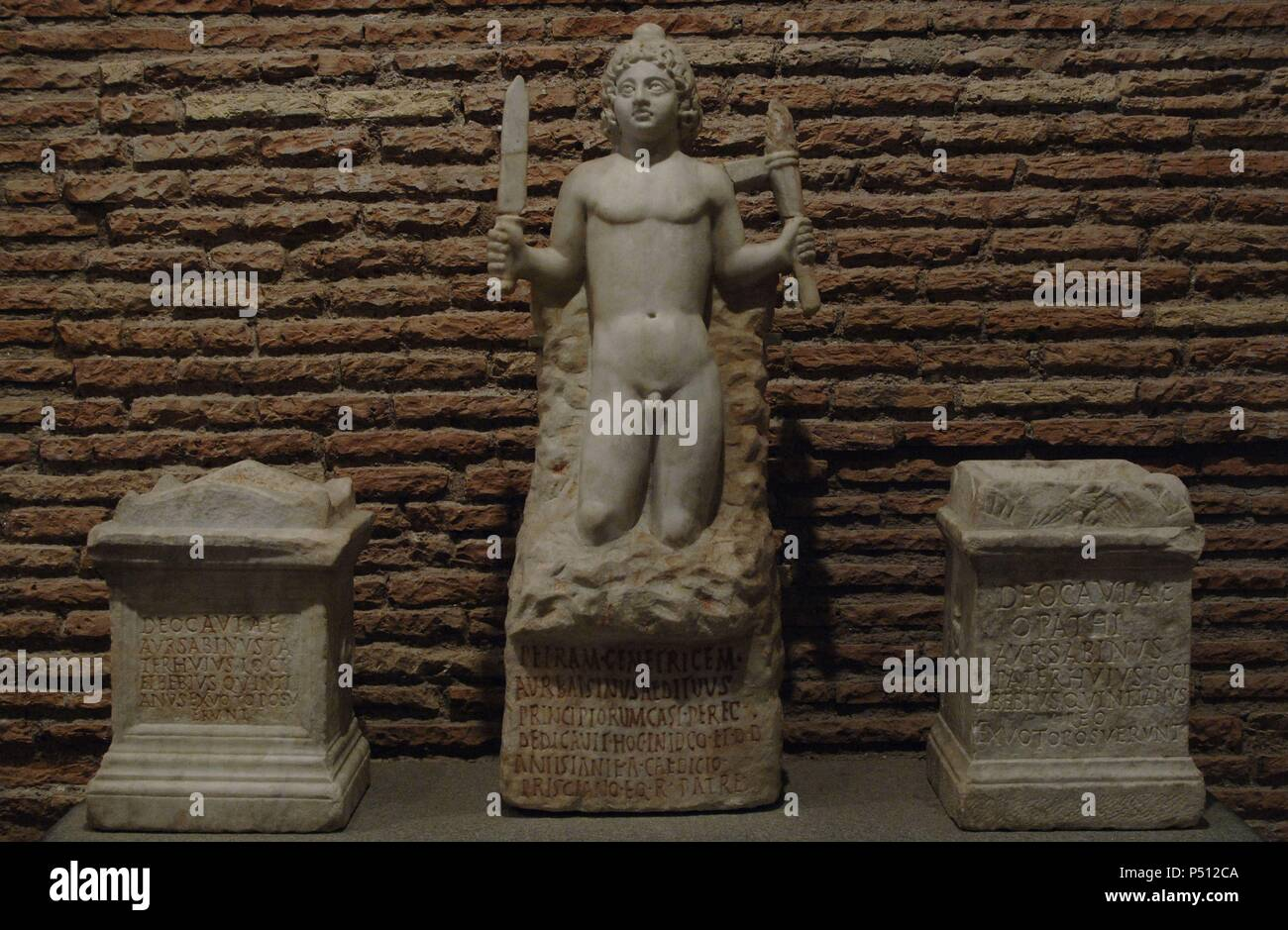 Three offerings for the Mitreo. Statue of Miter, dedicated by Aurelius Bassinus and two altars dedicated to Cautes and Cautopates. Era of Comodo (180-192). The Baths of Diocletian. National Roman Museum. Rome, Italy. - Stock Image