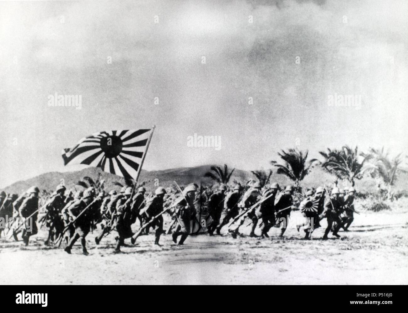 The Japanese Army, under the Bannar of the Rising Sun. Storm ashore on a Pacific Island. - Stock Image
