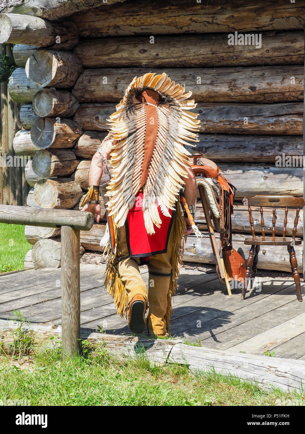 Man backside in costume of American Indian. portrait outdoors. France - Stock Image