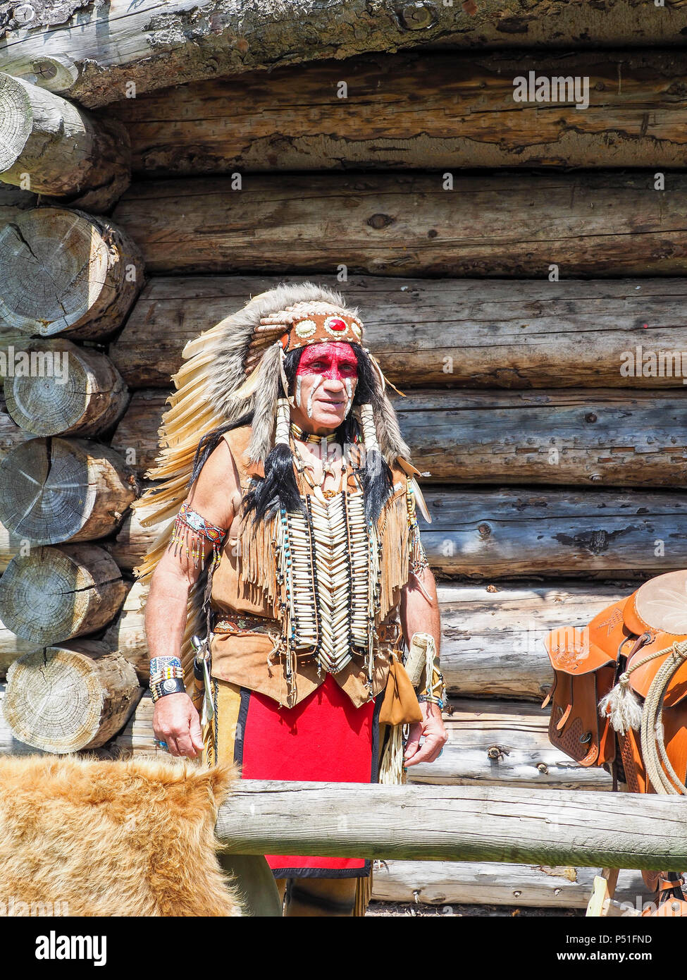 Documentary editorial image. ELBEUF, FRANCE - June 9, 2018. An unidentified man portrait in costume of American Indian. portrait outdoors. France - Stock Image