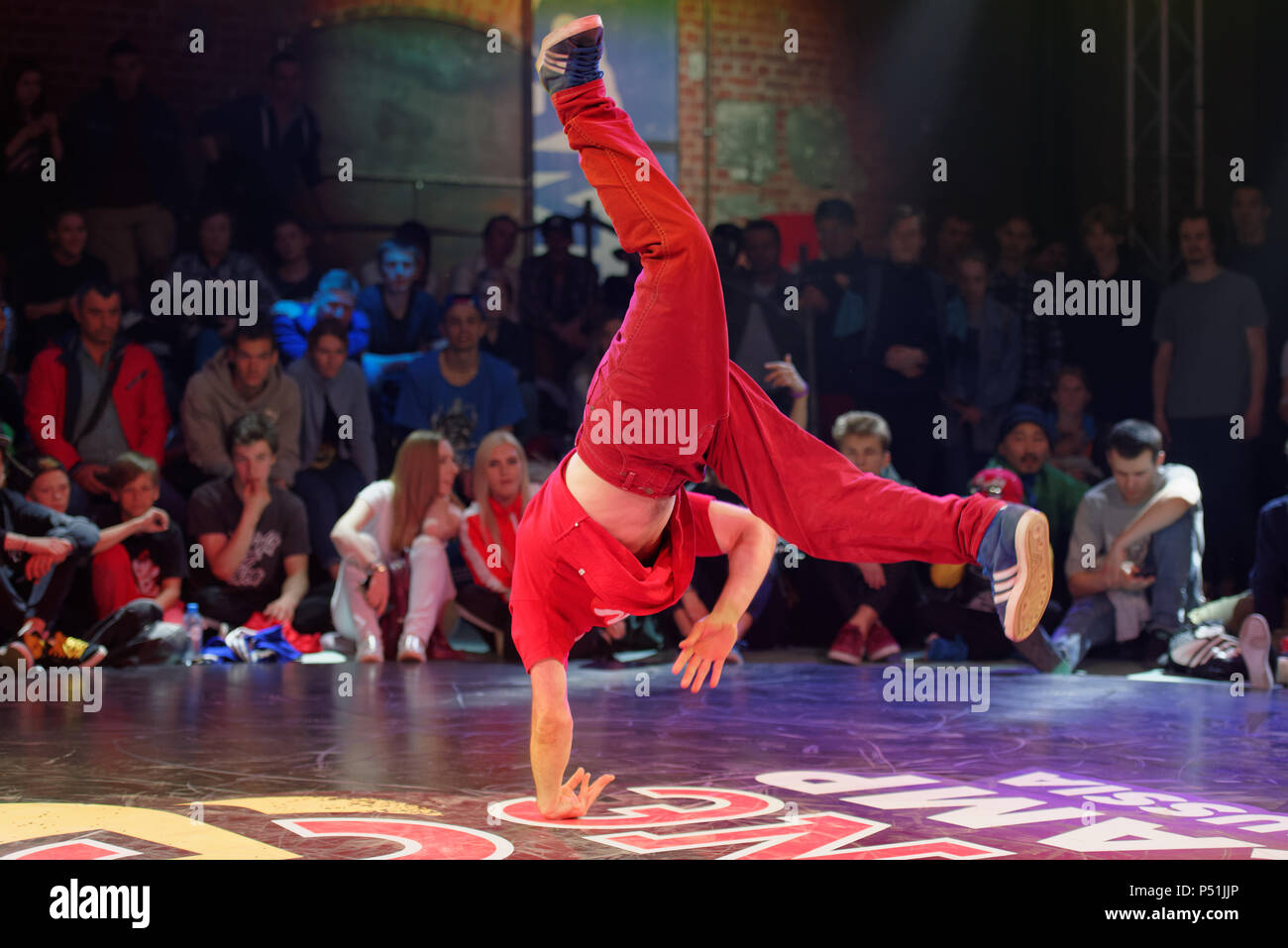 St. Petersburg, Russia - June 1, 2018: Unidentified breakdancer performs during a battle of Red Bull BC One Camp Russia 2018. Red Bull BC One is the b Stock Photo