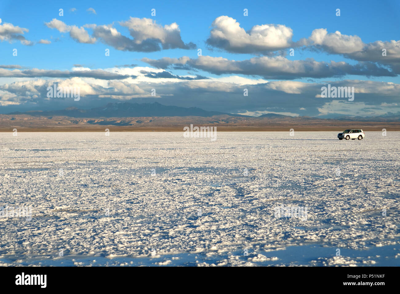 Driving on Salar de Uyuni or Uyuni Salts Flats, Bolivia, South America, UNESCO World Heritage - Stock Image