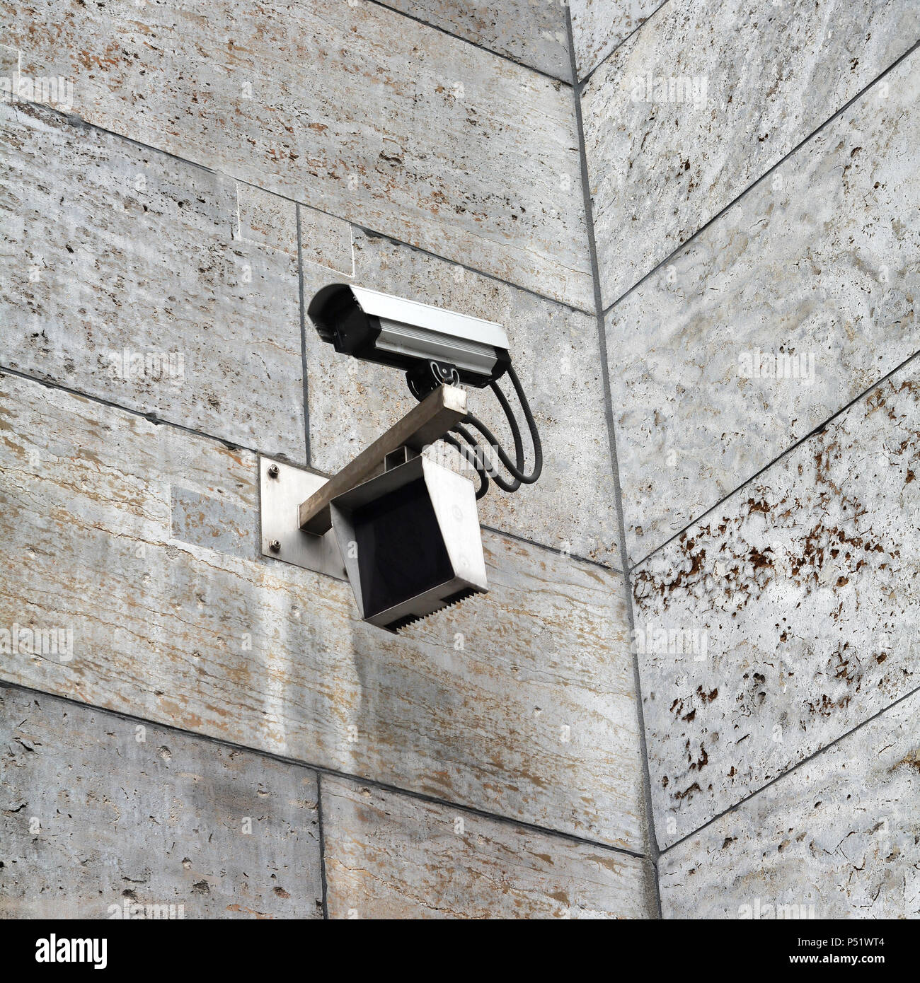 Video surveillance camera at a building in Berlin - Stock Image