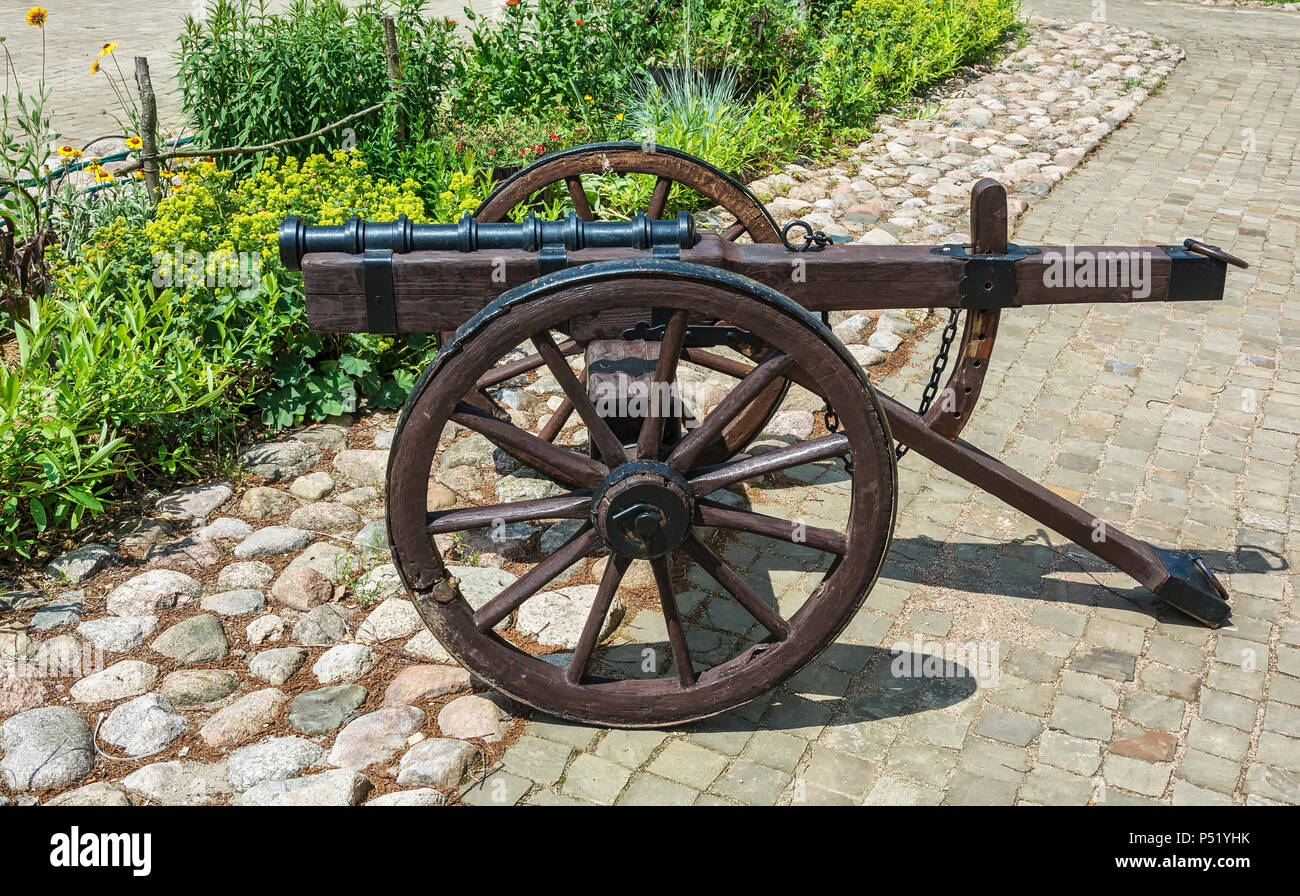 Old gun with adjustable carriage on wheels - Stock Image