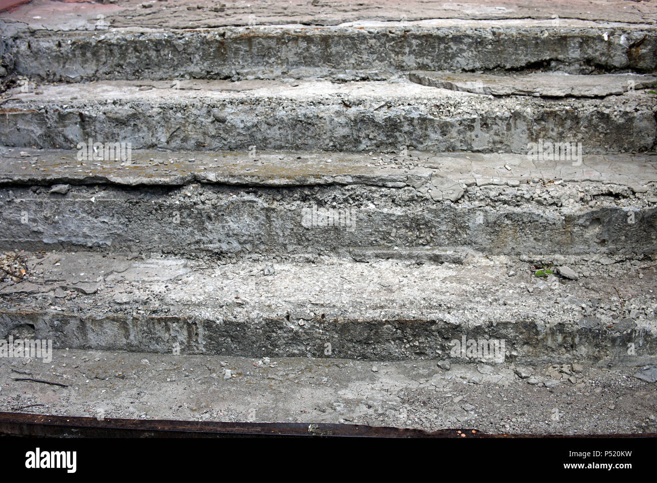 Old and shattered concrete steps leading nowhere - Stock Image