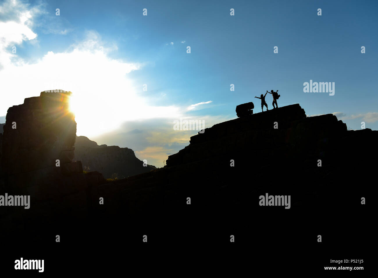 successful mountaineers on the summit rocks - Stock Image