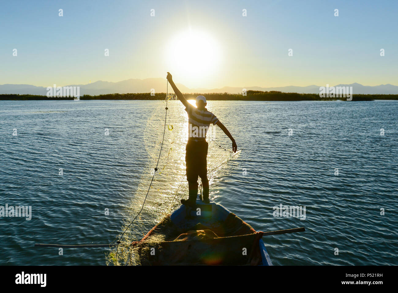 fishing and working hours - Stock Image