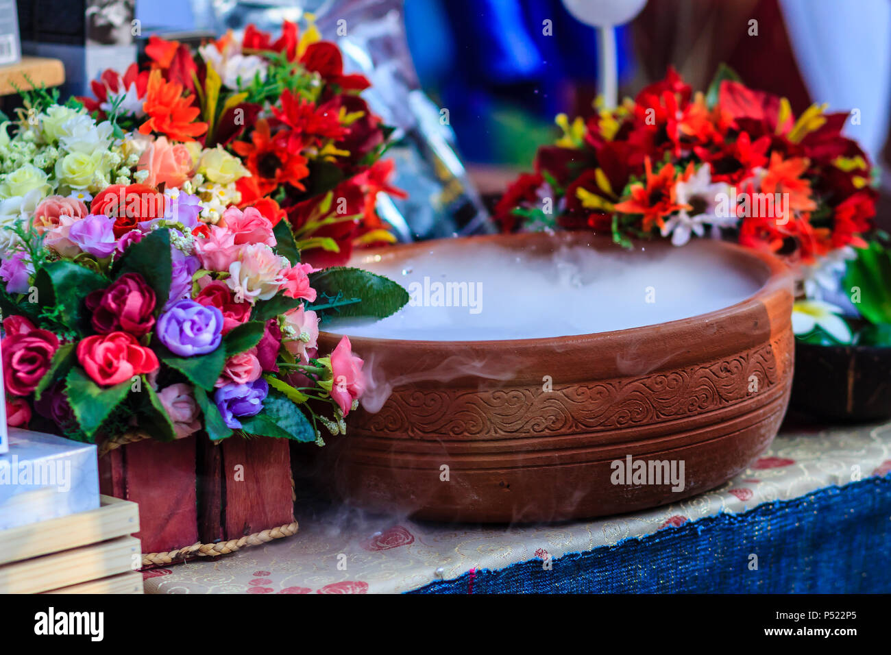 Beautiful Decoration In Spa Shop With Artificial Flowers And Dry Ice Smoke In The Ceramic Bowl Stock Photo Alamy