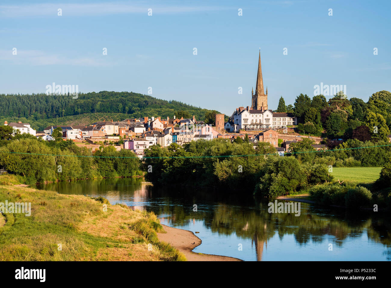 Ross on Wye, Herefordshire, UK. Photographed on a summer evening. Church spire reflected in the River Wye. - Stock Image