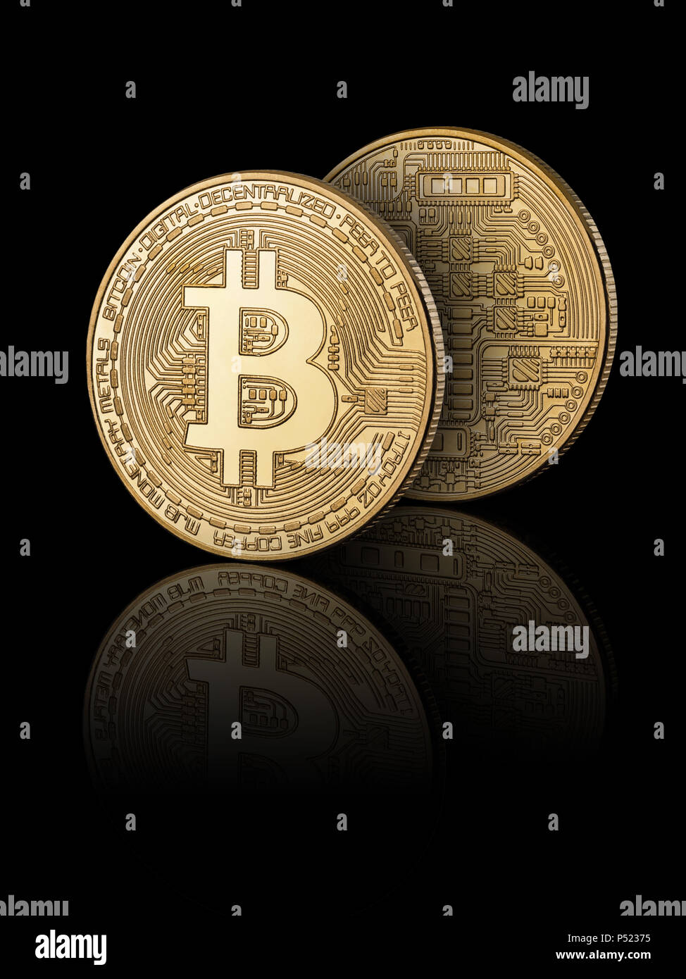 Bitcoin on black background with reflection  Obverse and reverse