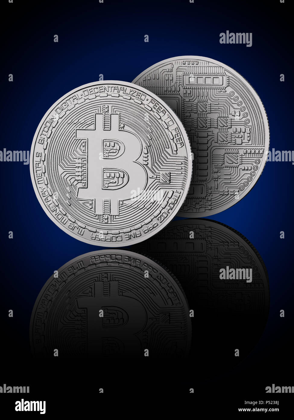 Bitcoin on black background with reflection. Obverse and reverse Stock Photo