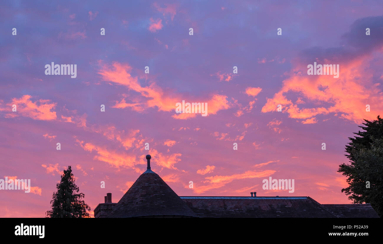 Bournemouth, Dorset, UK. 23rd June 2018. Sun setting as a sign of the heat wave ahead in the coming days. ©dbphots/Alamy Live News - Stock Image