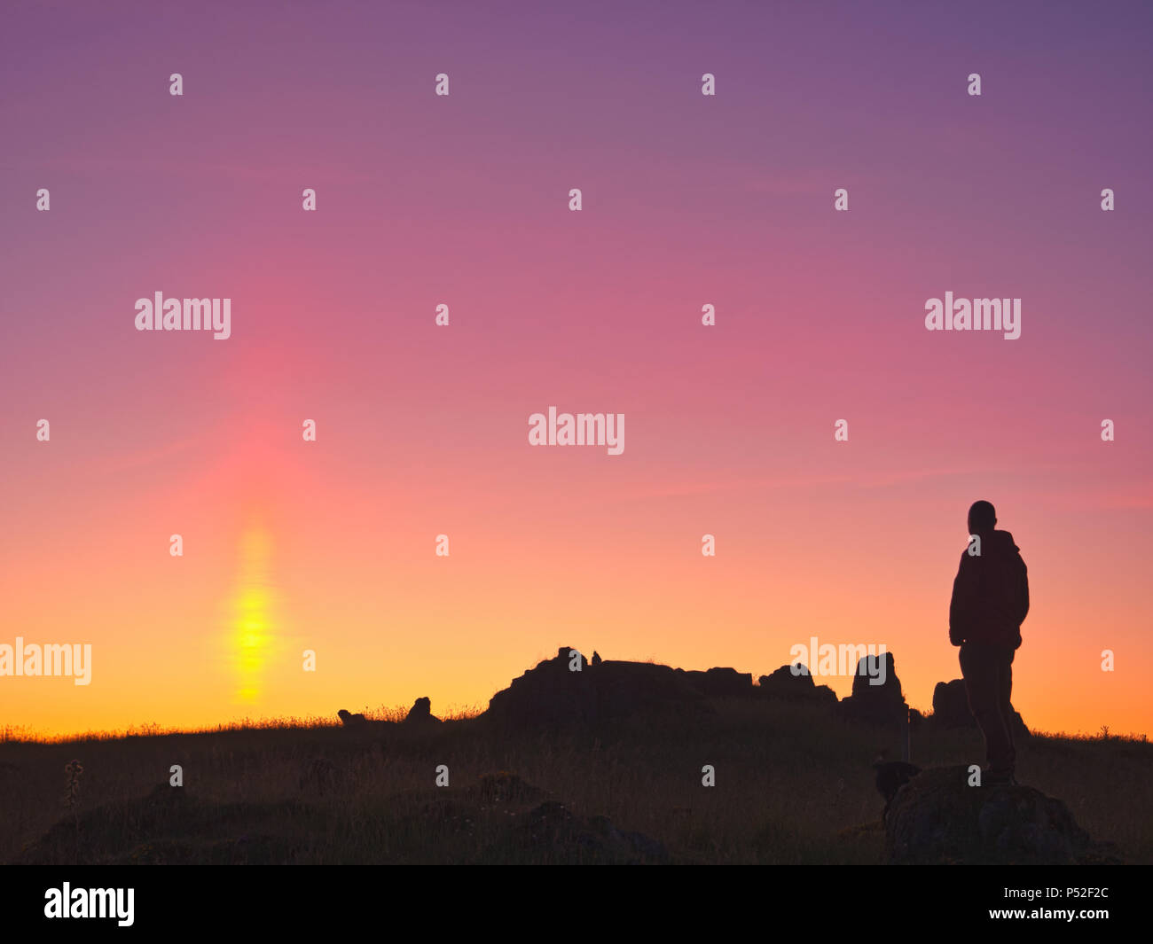 Brassington, Derbyshire, UK. 24th June, 2018. Weather UK: person watching the sun pillar solar column during an amazing sunset at Harborough Rocks near Brassington & the High Peak Trail, Derbyshire, Peak District National Park Credit: Doug Blane/Alamy Live News - Stock Image