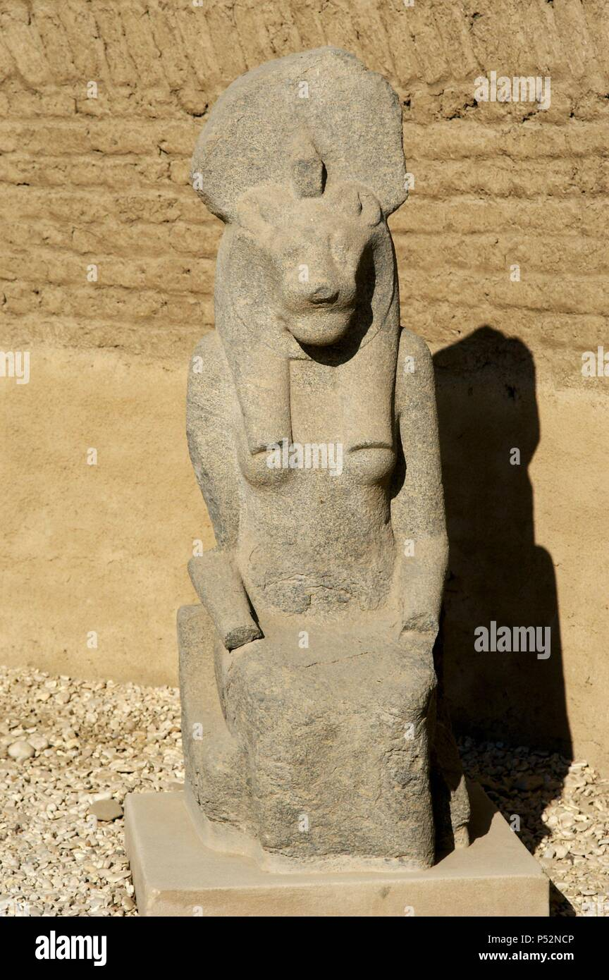 Statue of Goddess Sekhmet depicted with head of lioness and solar disk. Precinct of Mut. Karnak Temple Complex. Luxor. Egypt. Stock Photo