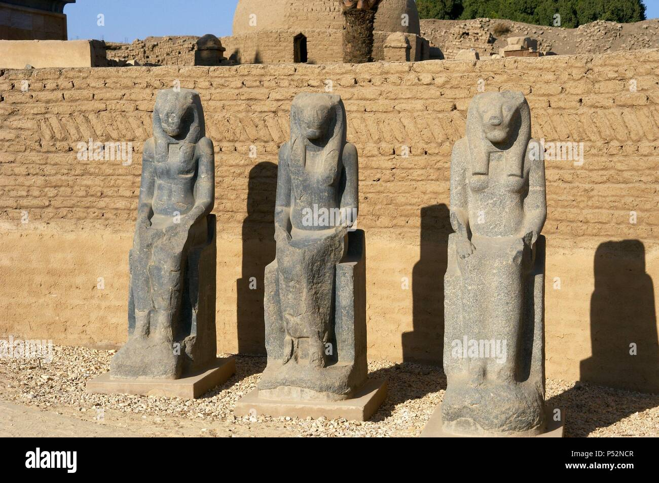 Statues of Goddess Sekhmet depicted with head of lioness and solar disk. Precinct of Mut. Karnak Temple Complex. Luxor. Egypt. Stock Photo