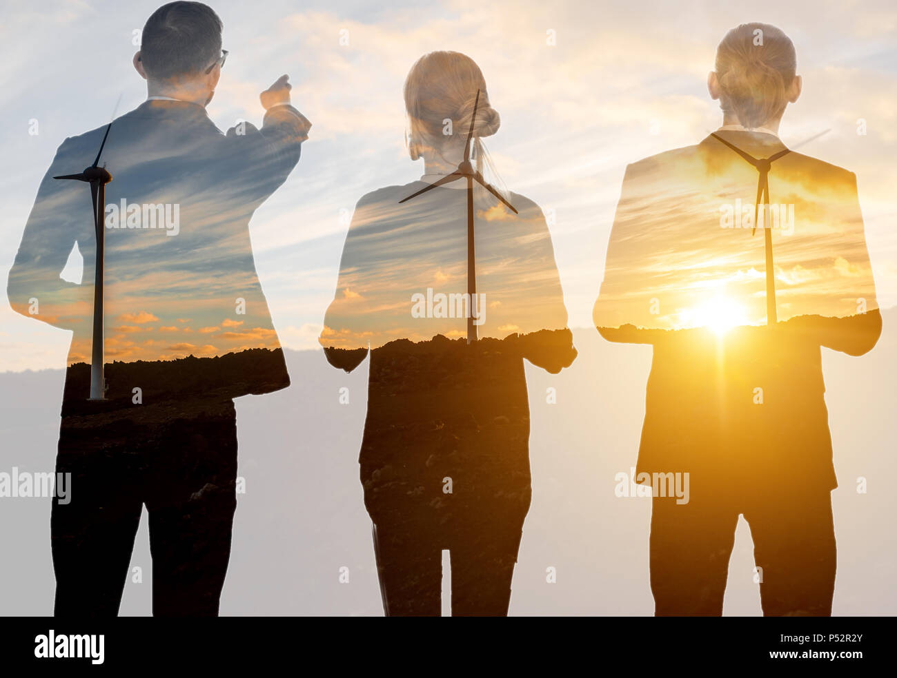 Double exposure with business people and wind turbines - Stock Image