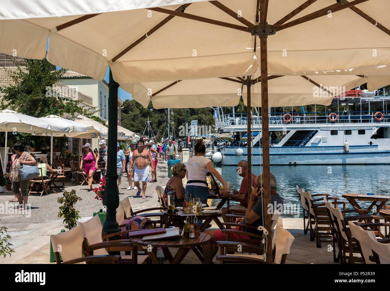 Tourists in Gaios, Paxos. - Stock Image