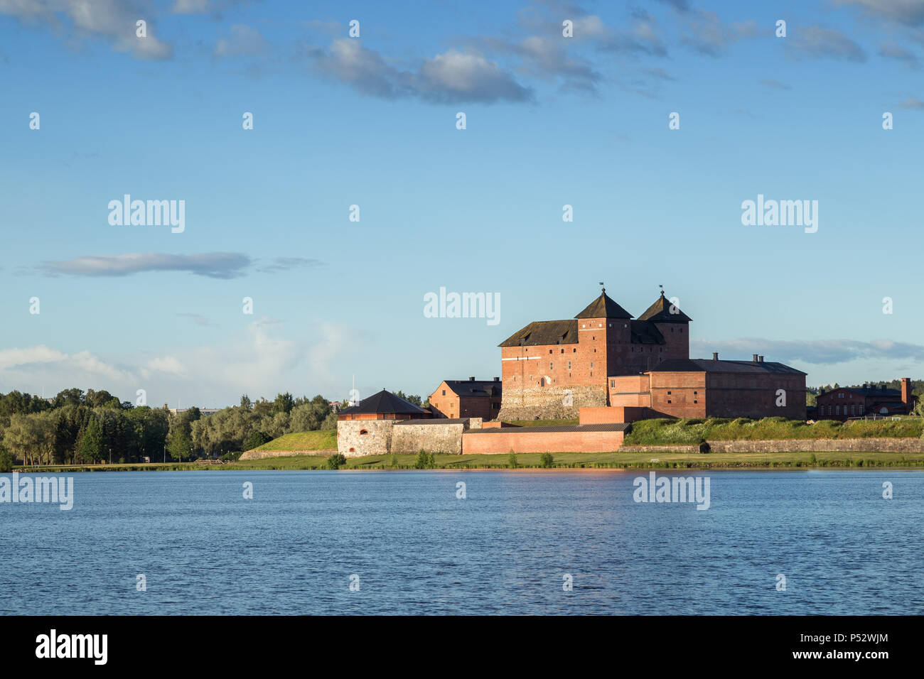 Beautiful view of the 13th century Häme Castle and lake Vanajavesi in Hämeenlinna, Finland, on a sunny day in the summer. Copy space. Stock Photo