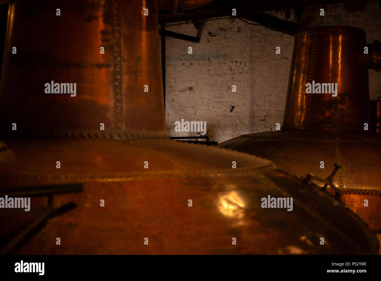 Close-up details of the Feints Still and Spirit Still in the Still House of the Old Jameson Whiskey Distillery in Midleton,County Cork,Ireland. - Stock Image