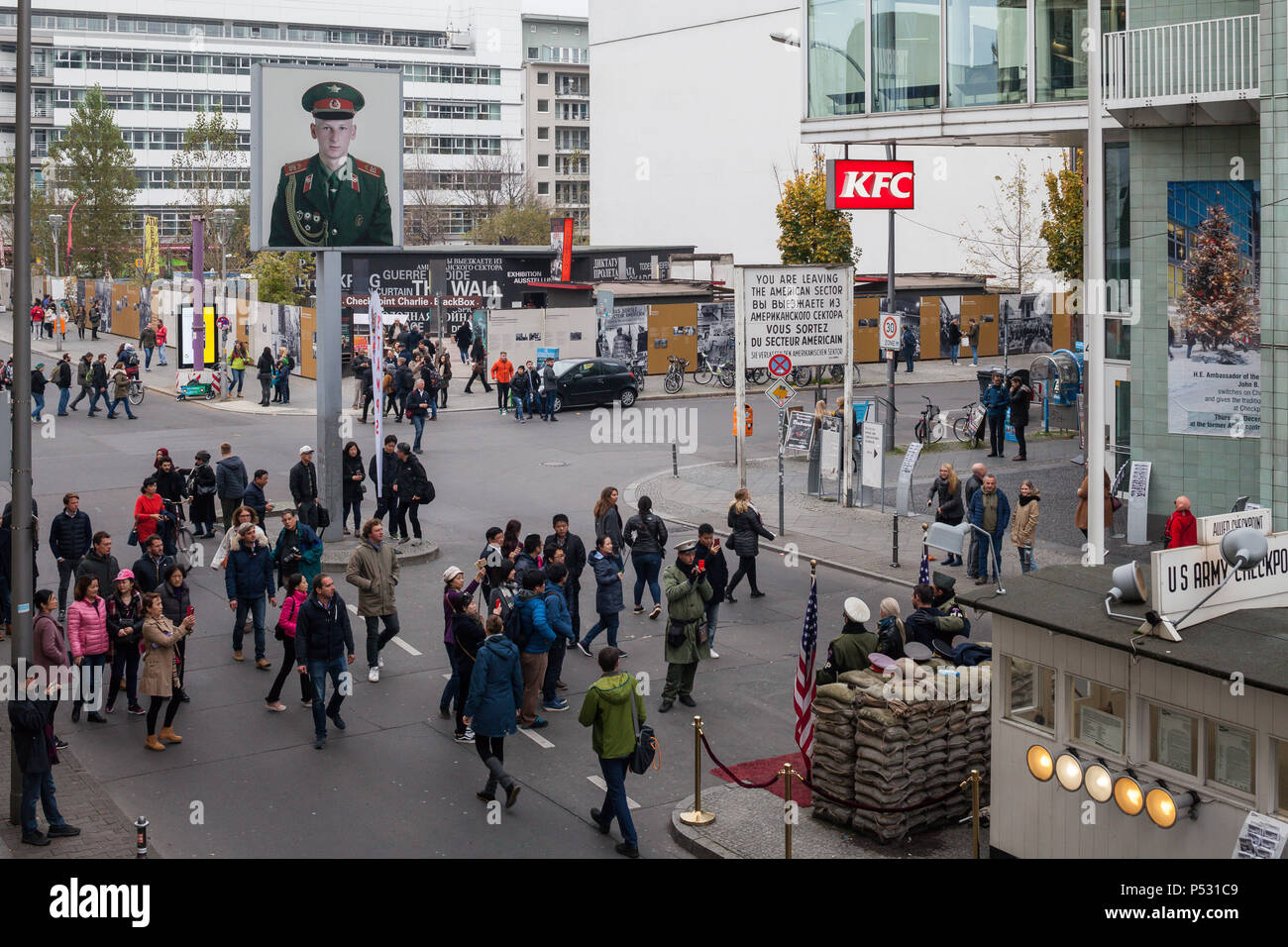 Berlin, Germany, tourists at Checkpoint Charlie in Friedrichstrasse in Berlin-Mitte - Stock Image