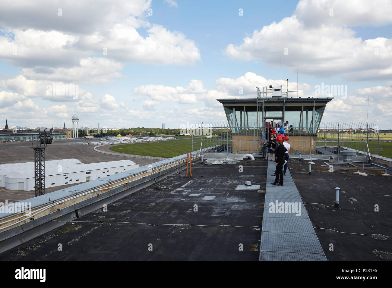 Berlin, Germany - View from the roof of the Kopfbaus West where a visitor's path is to be created. In the background the former tower of the airport Berlin Tempelhof and the Tempelhofer field. - Stock Image