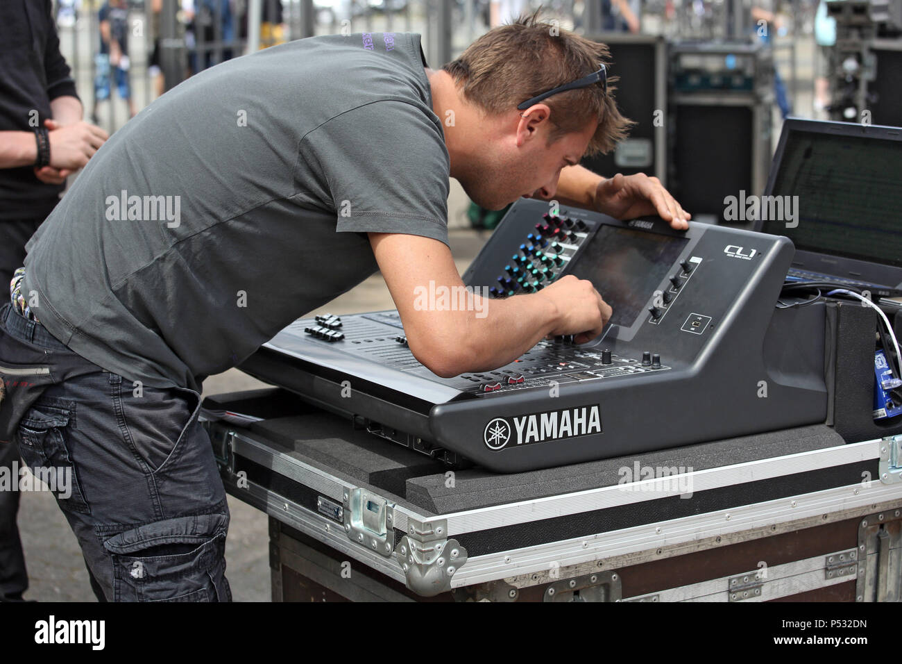 Hannover, Lower Saxony, Germany, sound engineer working on a mixing console Stock Photo