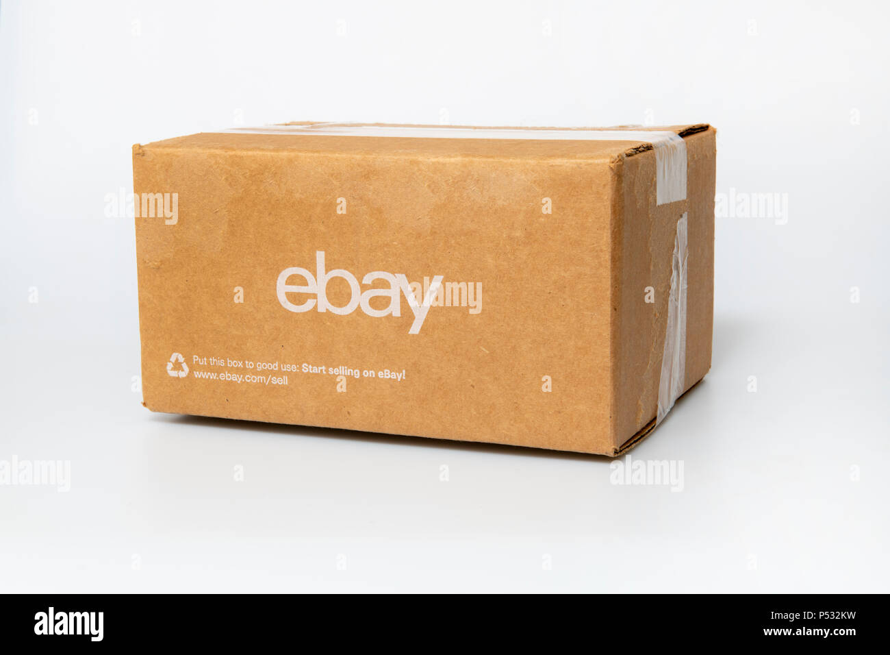 EBAY box on white shipping cardboard container for the auction site - Stock Image