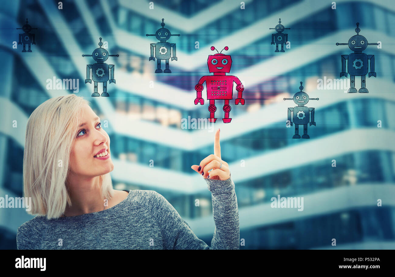 Beautiful blonde woman pointing her finger up choosing a different robot. Employee choice, group of artificial intellect replace human, leadership con - Stock Image