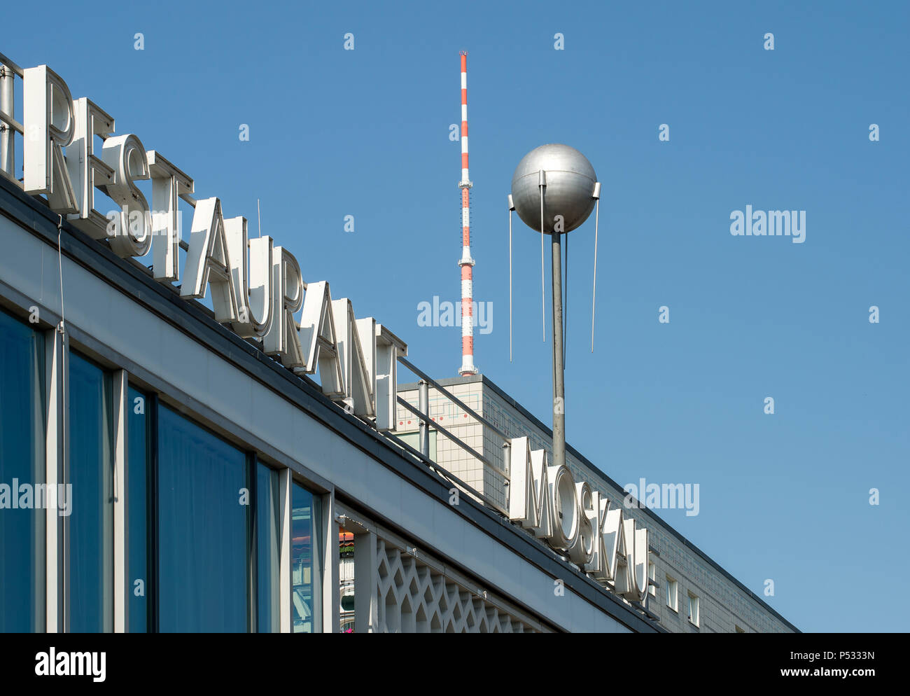 Detail of the Cafe Moskau with TV tower and a DDR-Plattenbau in the Karl-Marx-Allee - Stock Image