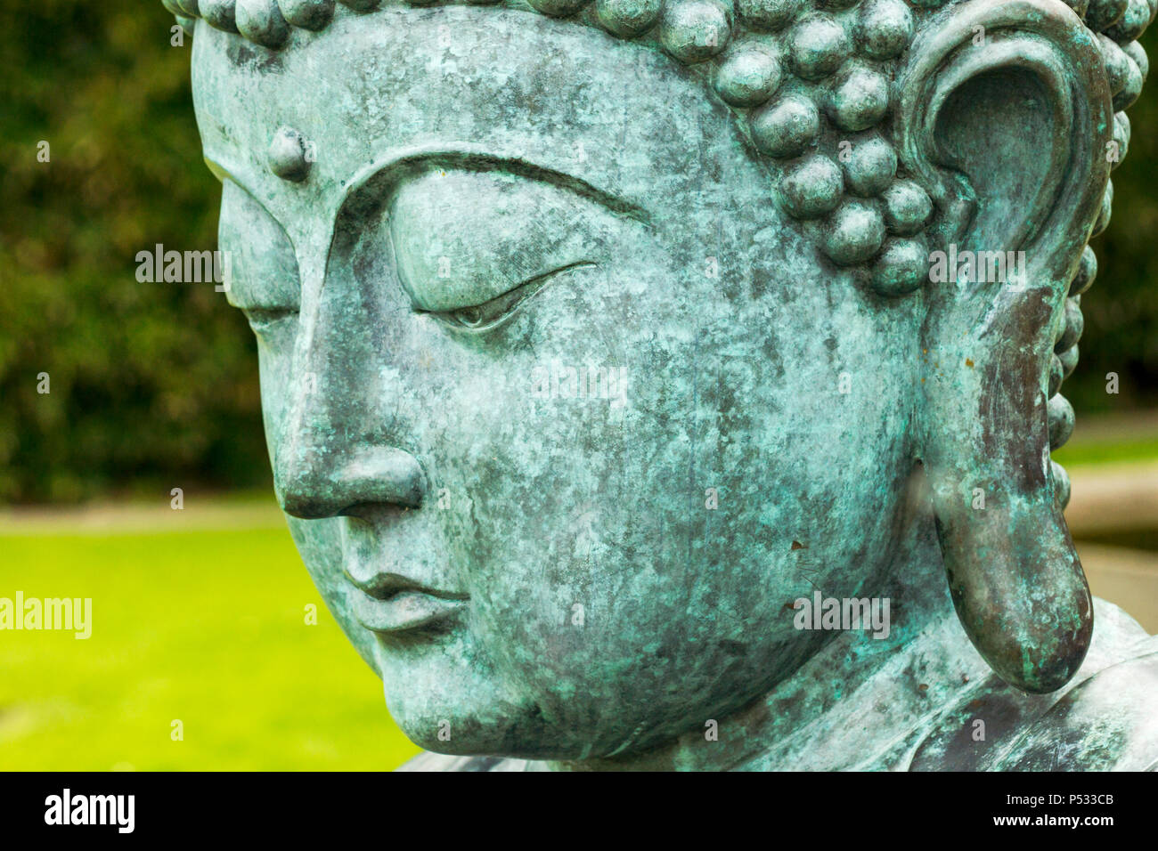 Buddha statue in a very beautiful park - Stock Image