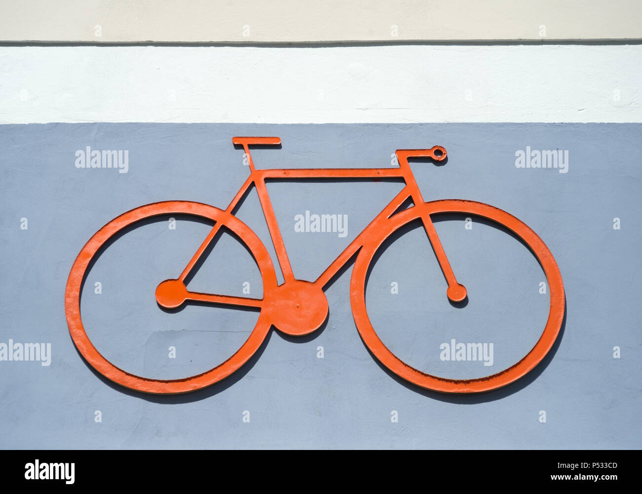 The pictogram of a bicycle on a house wall - Stock Image