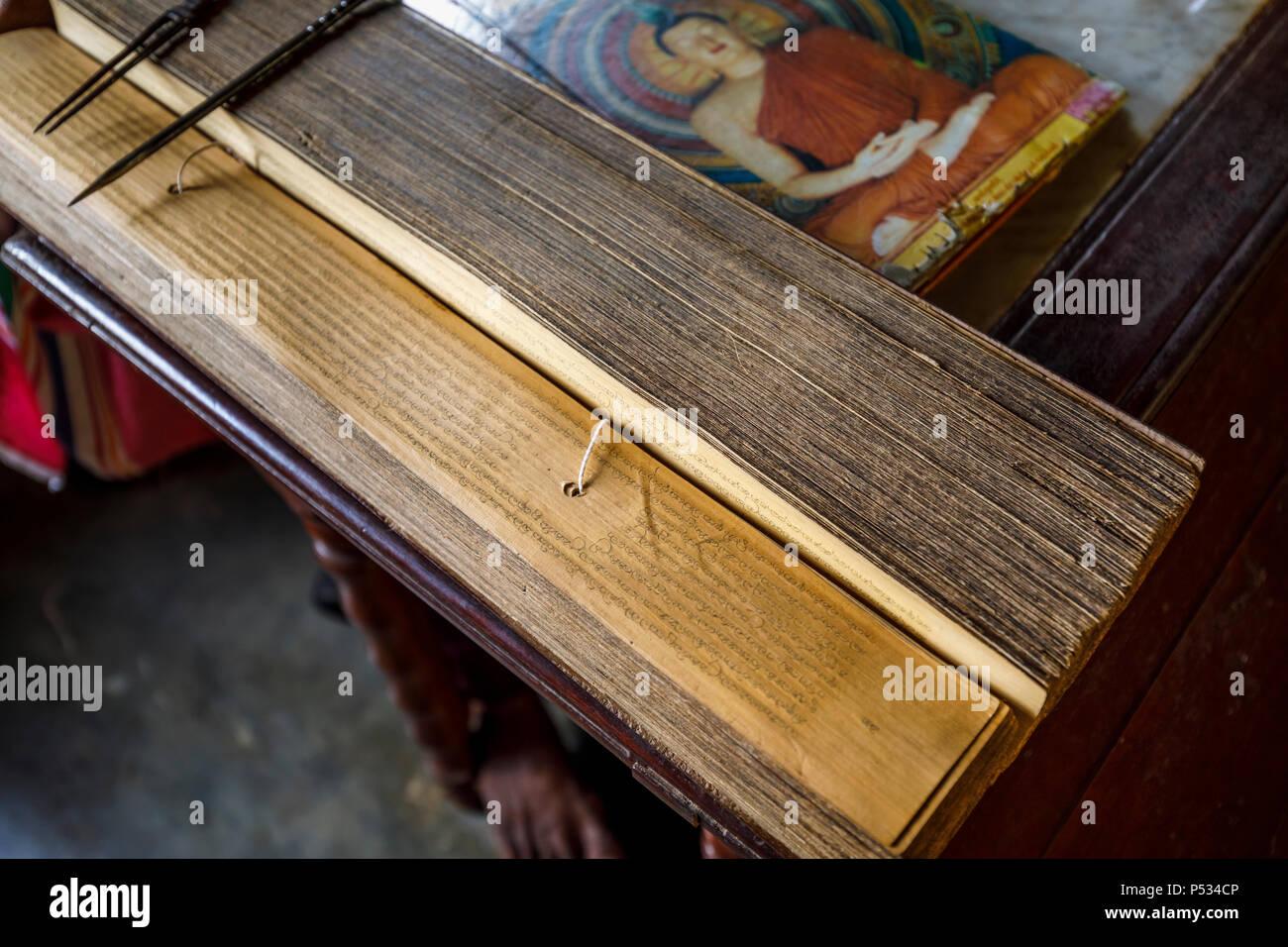 Typical hand-written loose leaf Buddhist book, Sri Wickramasinghe ancient temple, Maduwa Island on the Madu River, Maduganga Lake, southwest Sri Lanka - Stock Image