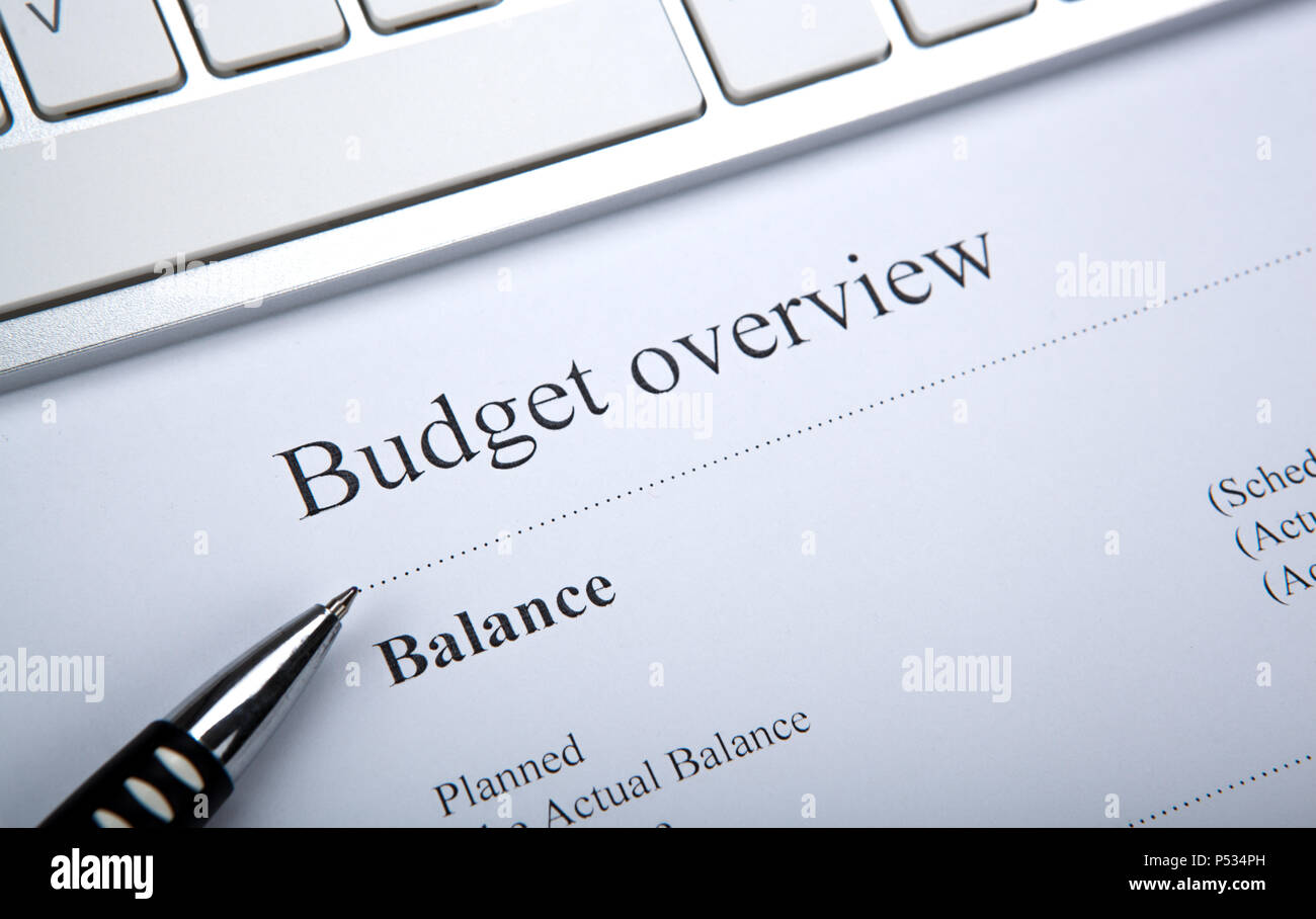 document with title budget overview and keyboard close up Stock Photo