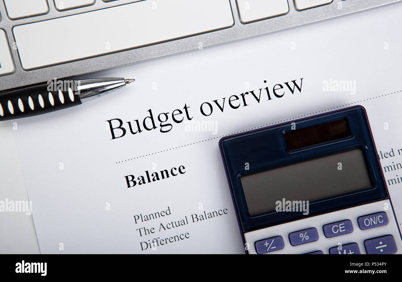 document with title budget overview and keyboard, calculator close up Stock Photo