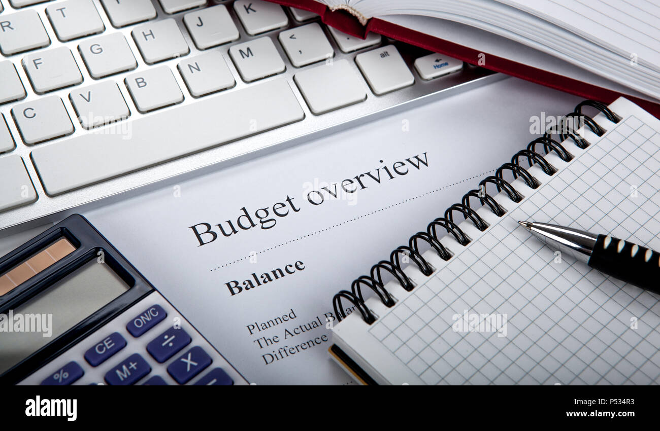 document with title budget overview and office tools close up Stock Photo