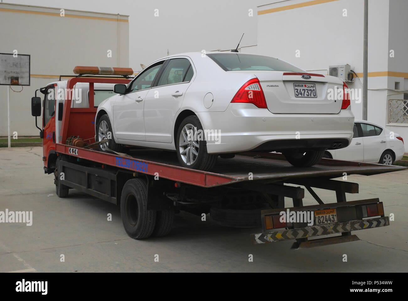 Broken down American Ford Fusion on  breakdown truck, Saar, Kingdom of Bahrain - Stock Image