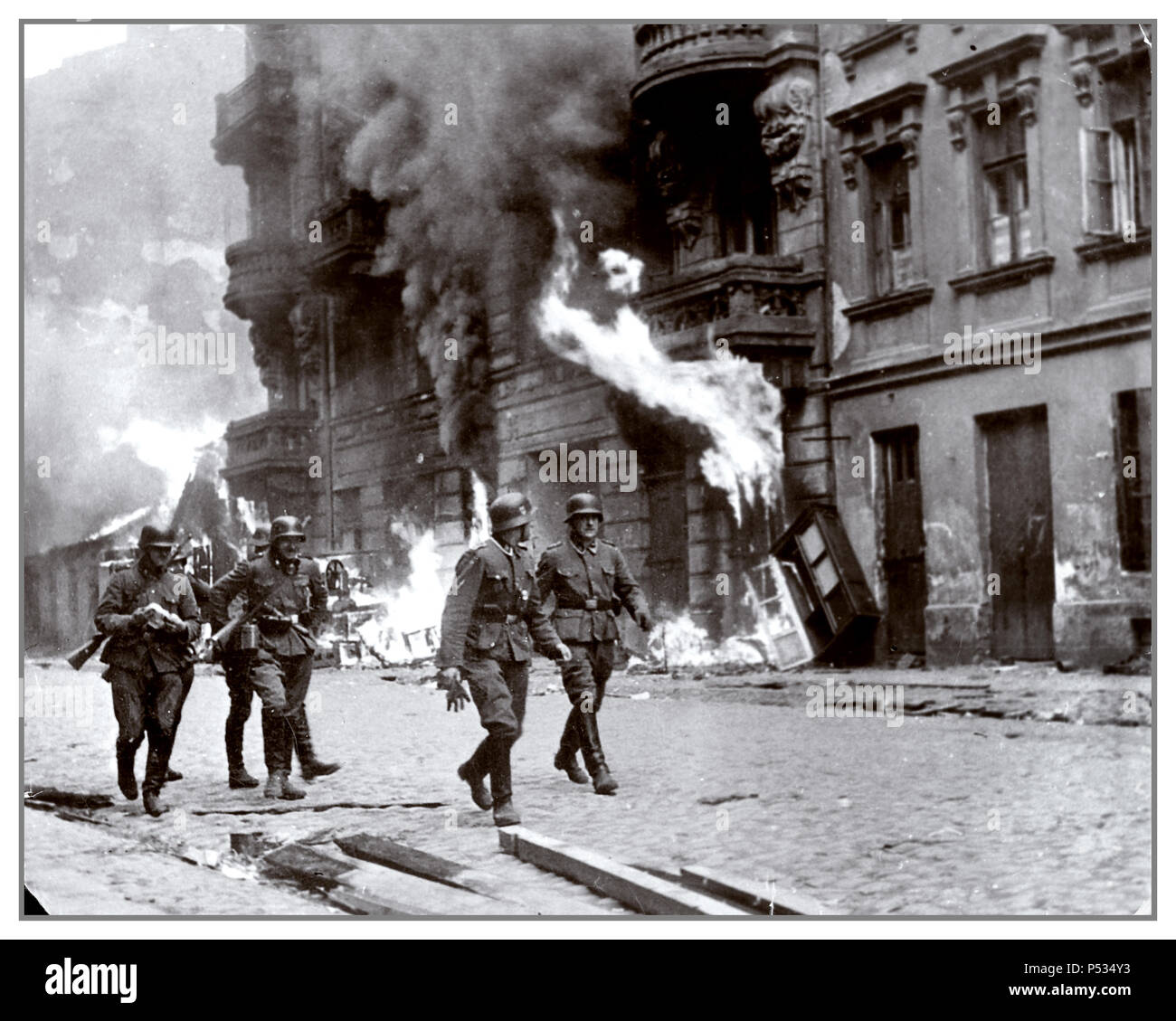 The liquidation of Warsaw Ghetto in May 1943 by Nazi Waffen SS troops. 'The Jewish Quarter of Warsaw is No More!' ..wrote Jürgen Stroop in the STROOP REPORT made for Heinrich Himmler about the brutal inhuman liquidation of Warsaw Ghetto in May 1943 This was a war crime used as evidence by United States Counsel for the Prosecution of Axis Criminality; Nuremberg Germany - Stock Image