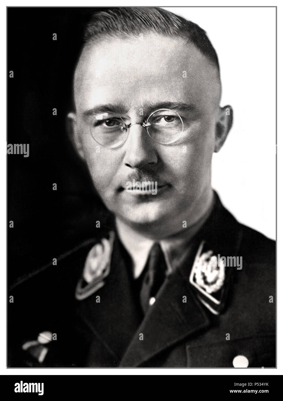 1940's WW2 Heinrich Himmler formal portrait in Waffen SS uniform German National Socialist Politician Nazi military commander secret police. Himmler was one of the most powerful men in Nazi Germany and one of the people most directly responsible for the Holocaust. Facilitated genocide across Europe and the east. Committed suicide in 1945 after being captured fleeing under another identity. - Stock Image