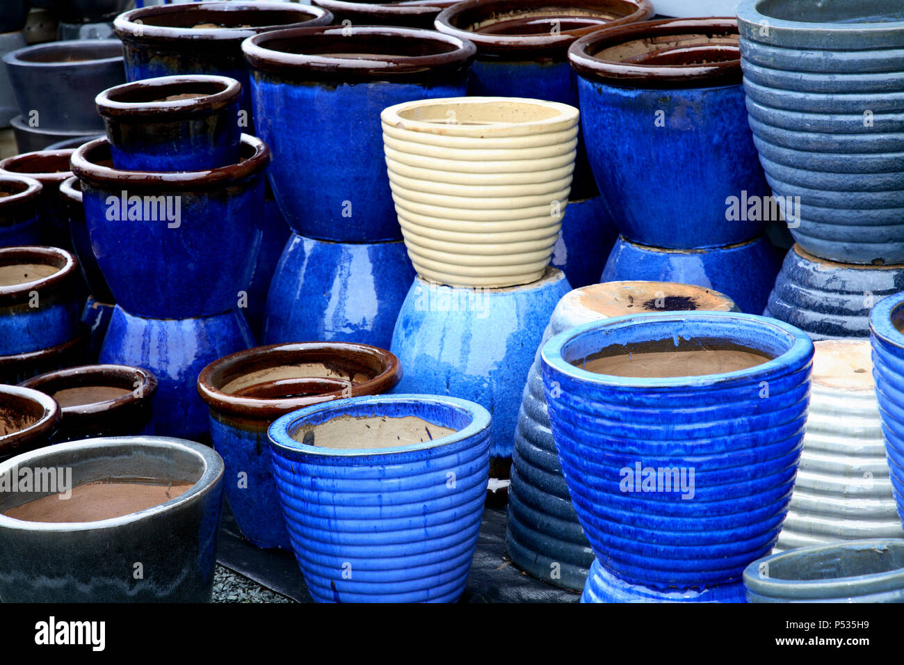 Empty blue and white flower pots stock photo 209667957 alamy empty blue and white flower pots mightylinksfo