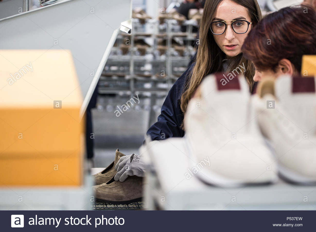 Tod's opening to Arquata del Tronto (AP) - 20th December 2017 | workers during the production of shoes. - Stock Image