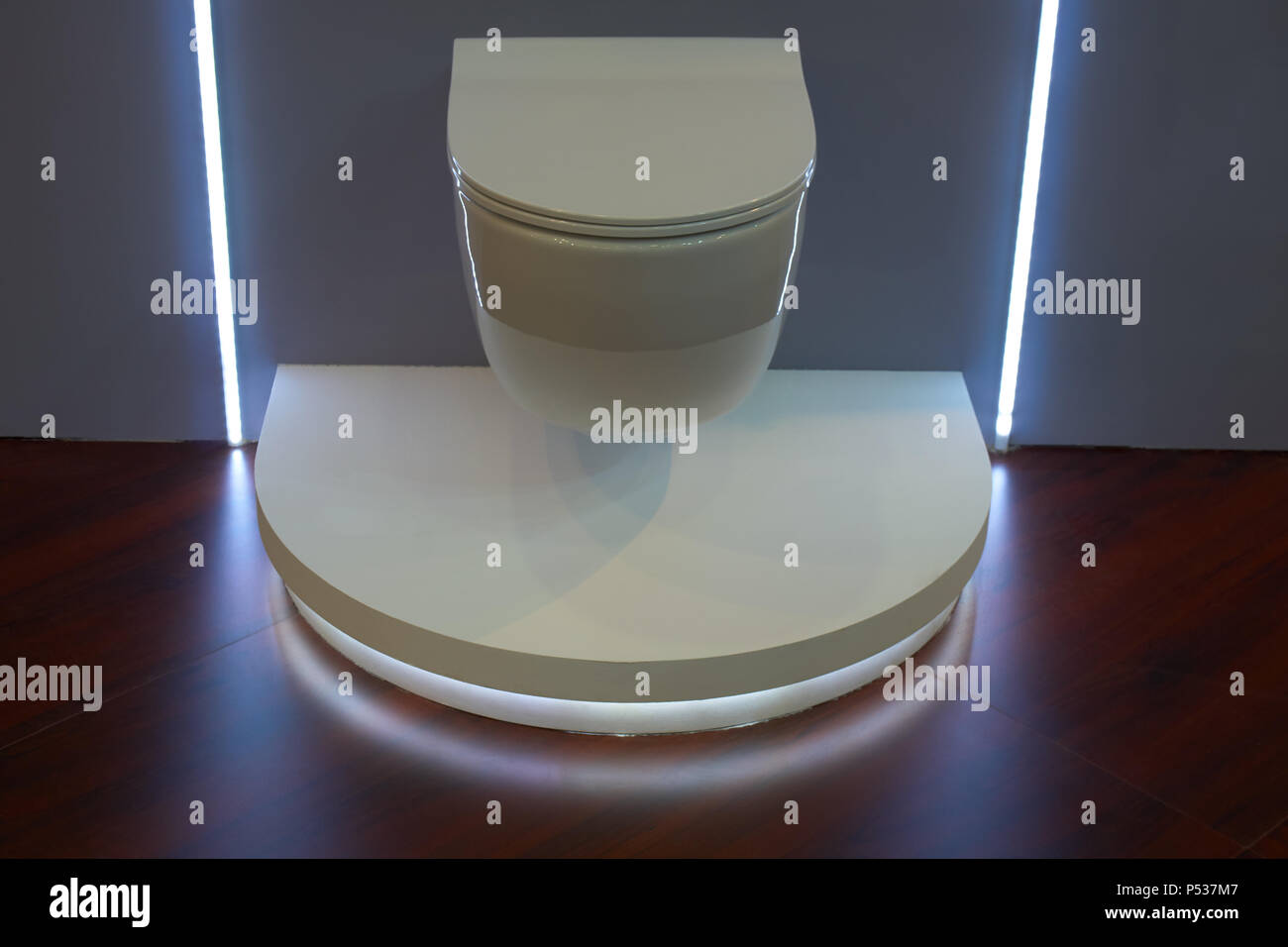 White modern led lit toilet in restroom - Stock Image