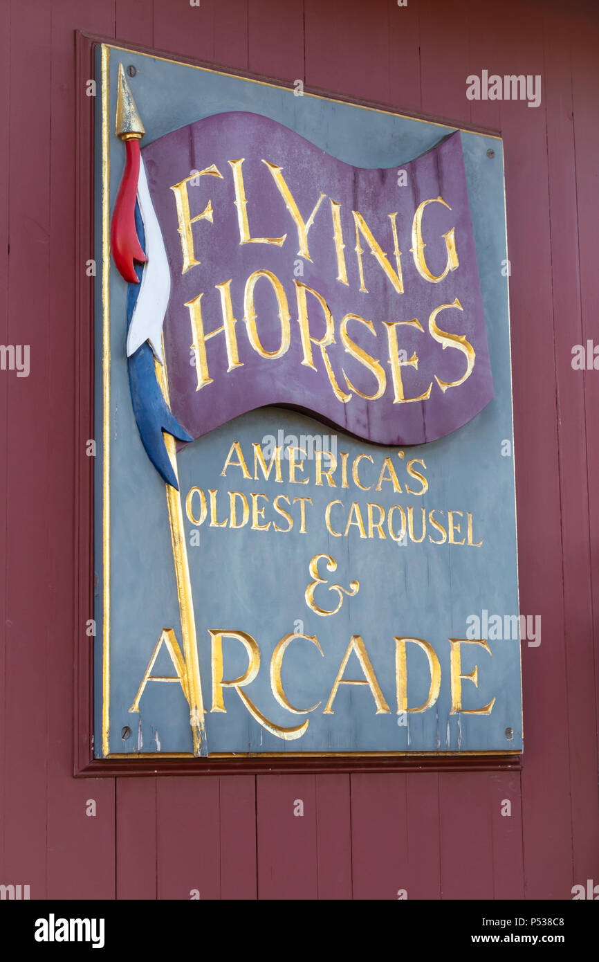 A sign on the side of the building housing the Flying Horses Carousel in Oak Bluffs, Massachusetts on Martha's Vineyard - Stock Image