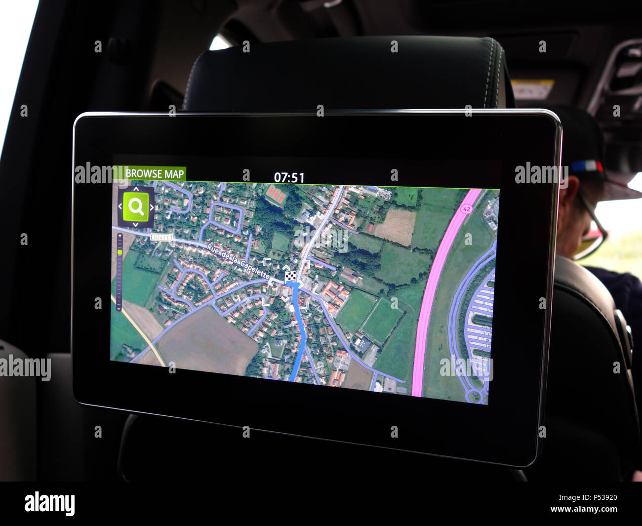 Rear seating individual TV Monitor and entertainment system with Sat Nav route showing live infomation for the rear seated passenger on route - Stock Image