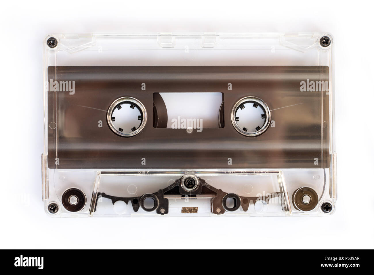 Translucent audio cassette tape isolated on white background - Stock Image