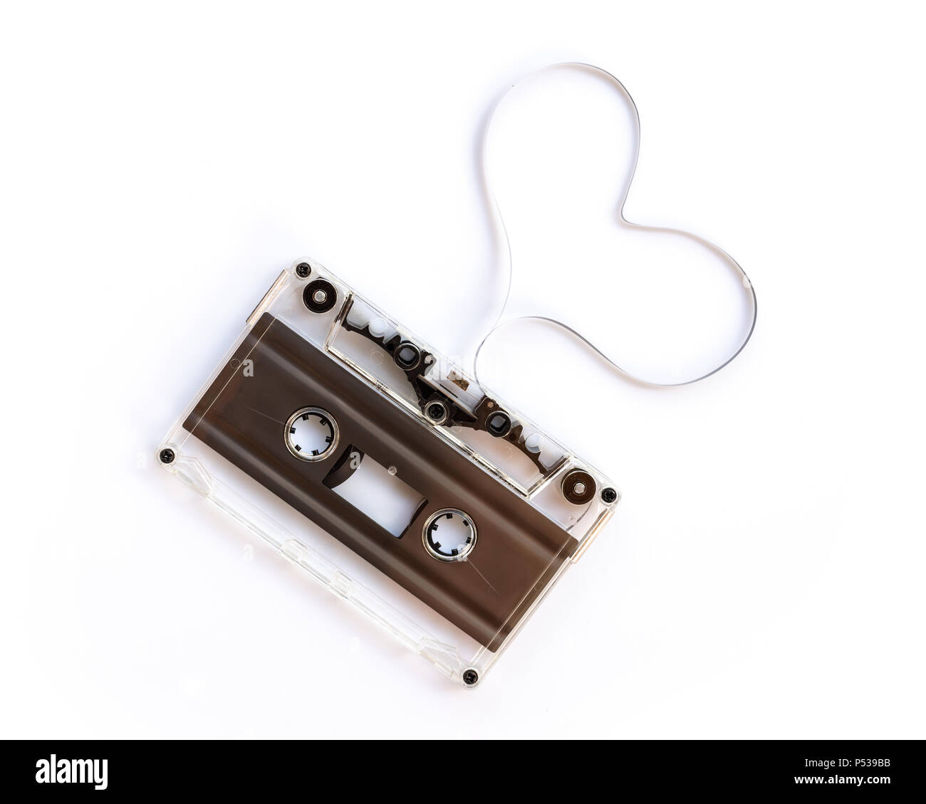 Translucent audio cassette with the magnetic tape in the shape of a heart  isolated on white background, music love concept - Stock Image