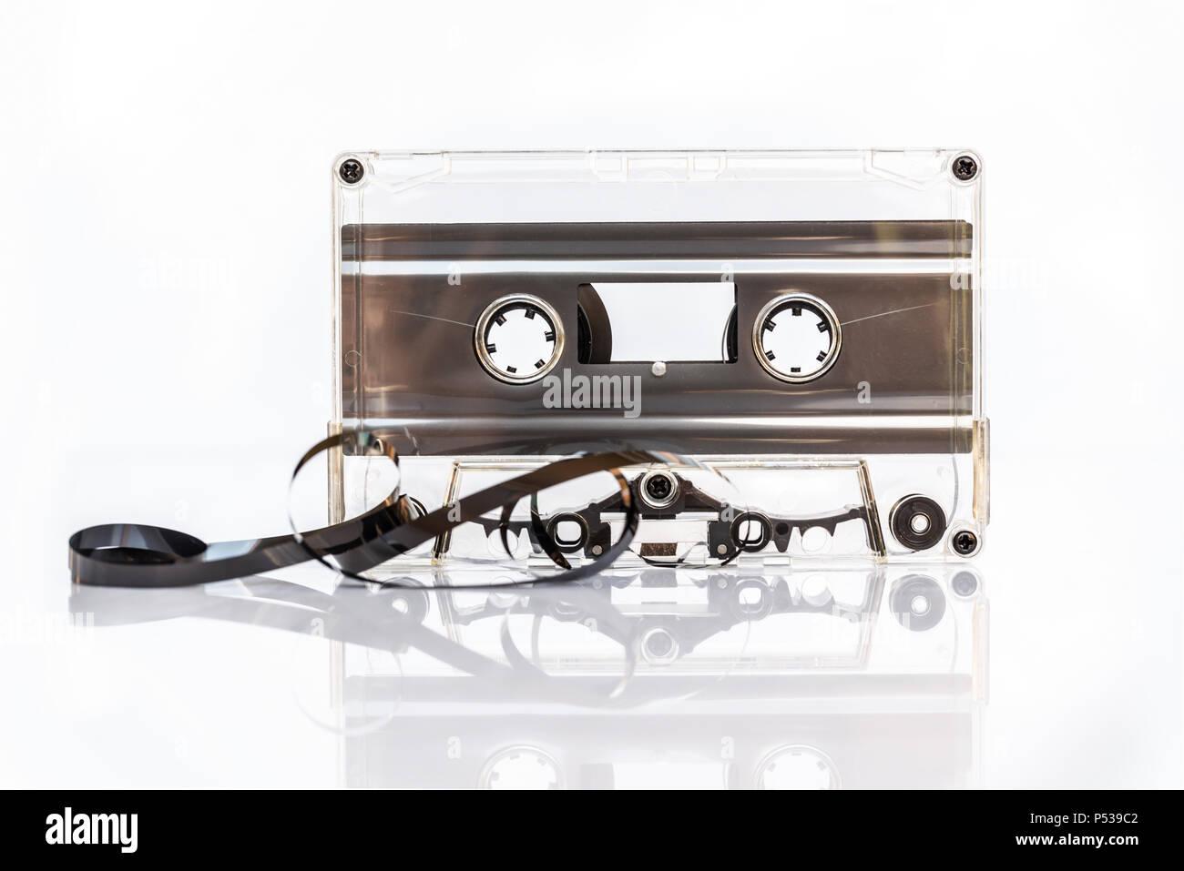 Translucent audio cassette tape isolated on white background - Stock Image