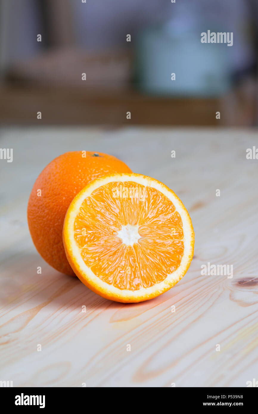 half slide of fresh nature ripe orange on wooden table high vitamin